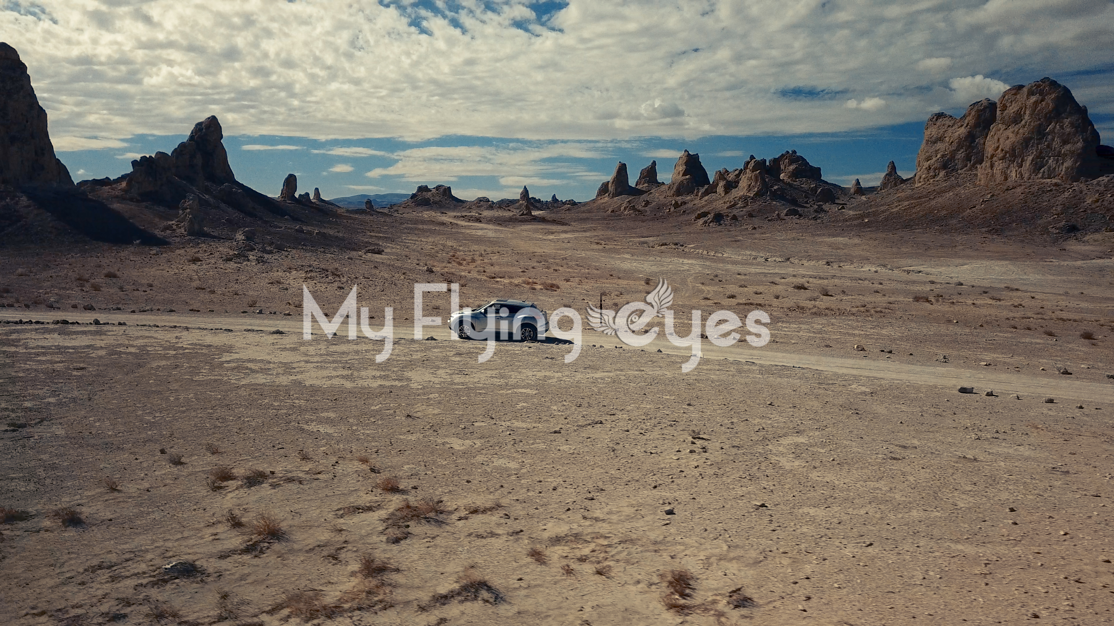 Car Driving Trough Desert Rock Formations Aerial Photography My Flying Eyes